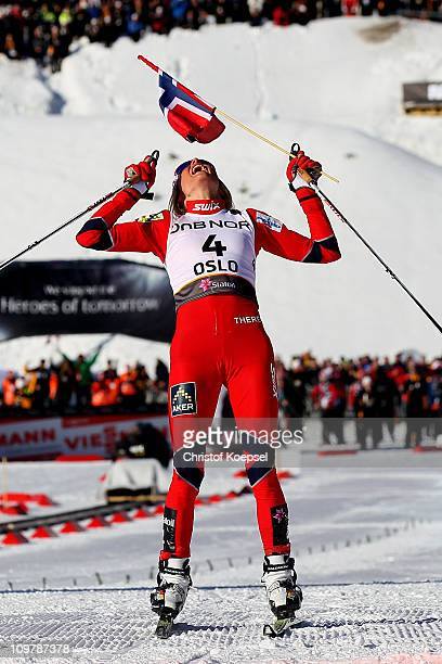 Therese Johaug of Norway celebrates after crossing the finish line to win the gold medal in the Ladies Cross Country 30km Mass Start race during the...