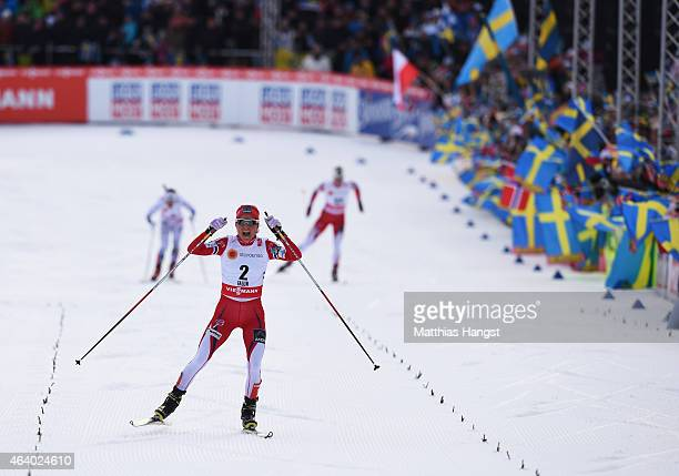 Therese Johaug of Norway celebrates as she wins the gold medal in the Women's 15km CrossCountry Skiathlon during the FIS Nordic World Ski...