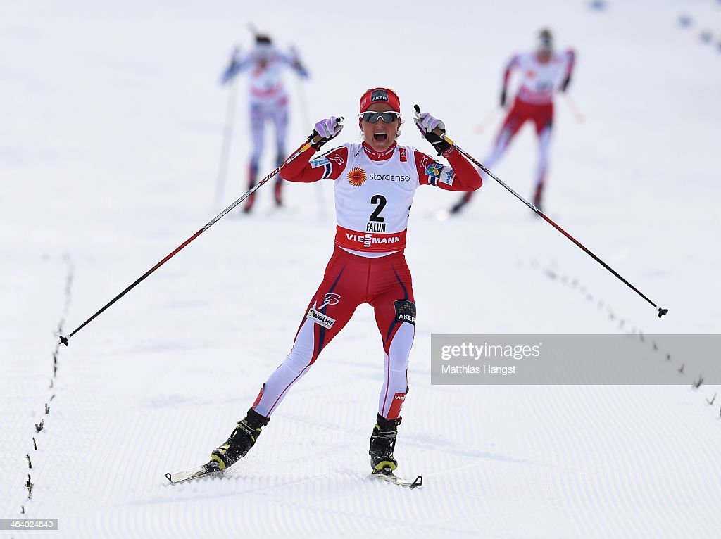 Therese Johaug of Norway celebrates as she wins the gold medal in the Women's 15km Cross-Country Skiathlon during the FIS Nordic World Ski Championships at the Lugnet venue on February 21, 2015 in Falun, Sweden.