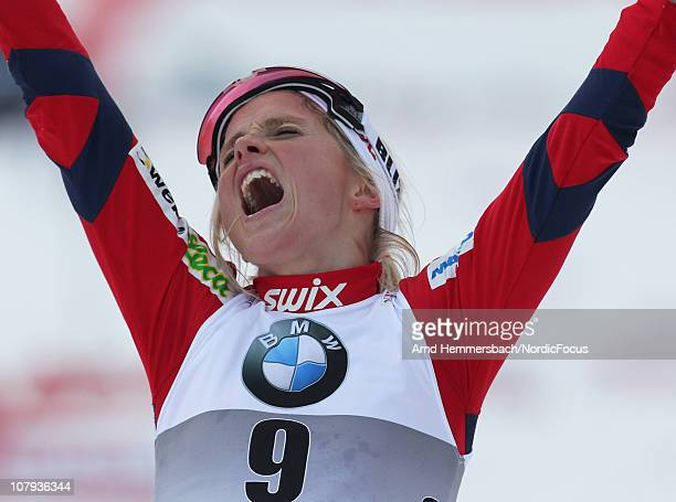 Therese Johaug of Norway celebrates her 2nd place during the mass women for the FIS Cross Country World Cup Tour de Ski on January 8 2011 in Val di...