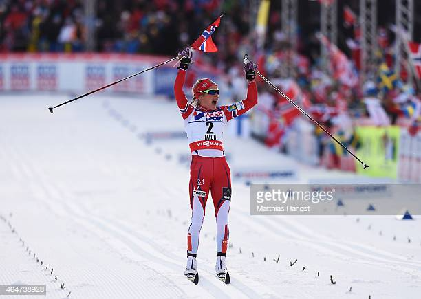 Therese Johaug of Norway celebrates on the way to winning the gold medal in the Women's 30km Mass Start CrossCountry during the FIS Nordic World Ski...