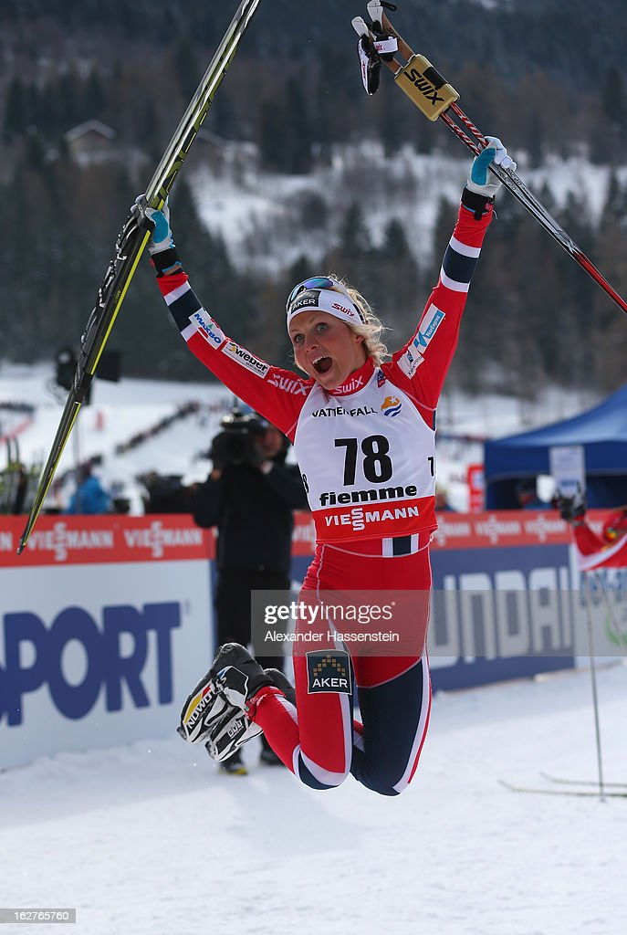 Therese Johaug of Norway celebrates victory in the Women's Cross Country Individual 10km at the FIS Nordic World Ski Championships on February 26, 2013 in Val di Fiemme, Italy.