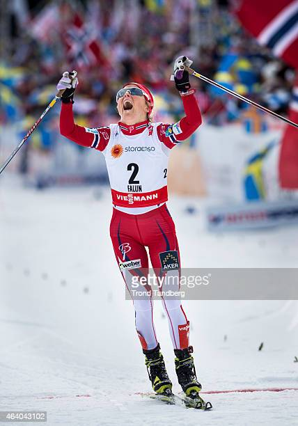 Therese Johaug of Norway celebrates winning the gold medal at the Ladies Skiathlon 75 Classic 75 km Free during the World Championship Cross Country...