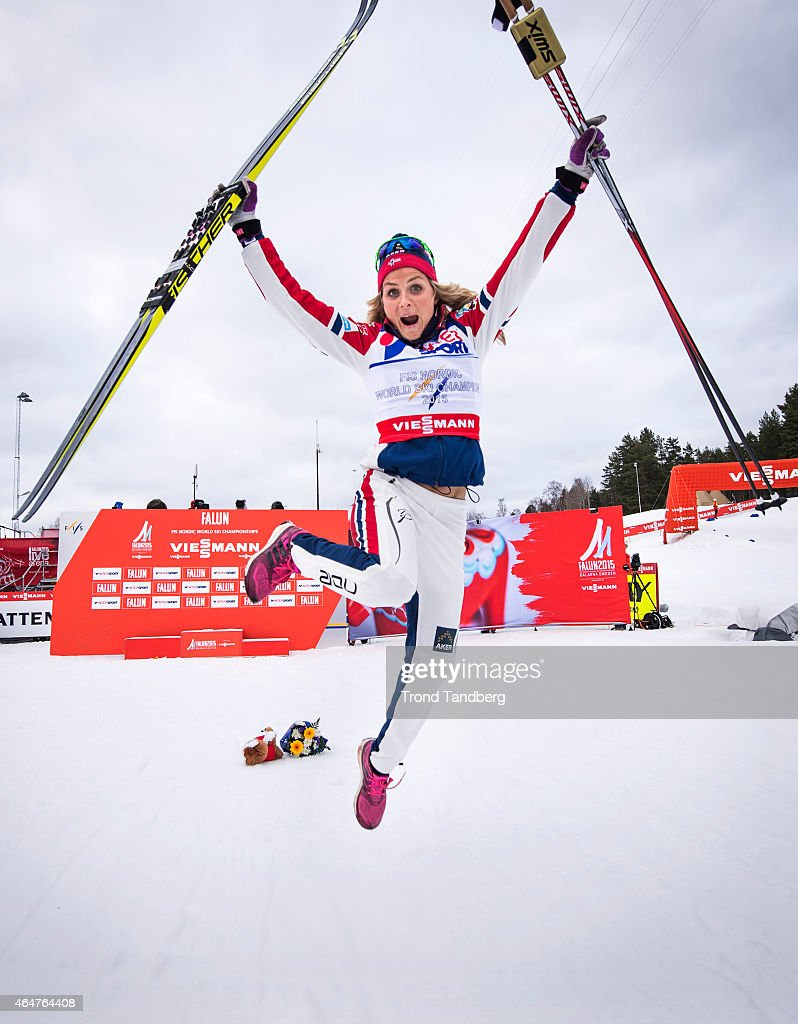 Therese Johaug of Norway celebrates winning the gold medal during the Ladies 30.0 km Mass Start Classic during the FIS Nordic World Ski Championships at the Lugnet venue on February 28, 2015 in Falun, Sweden.