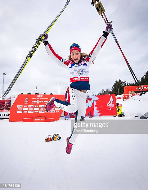 Therese Johaug of Norway celebrates winning the gold medal during the Ladies 300 km Mass Start Classic during the FIS Nordic World Ski Championships...
