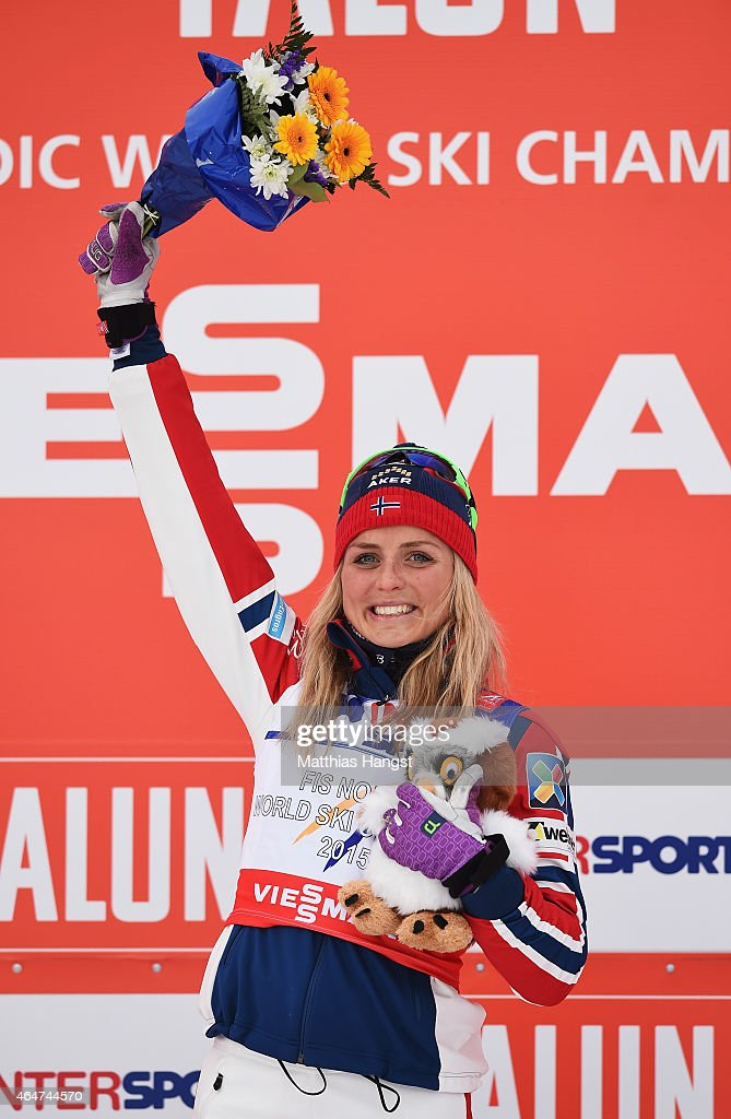 Therese Johaug of Norway celebrates winning the gold medal in the Women's 30km Mass Start Cross-Country during the FIS Nordic World Ski Championships at the Lugnet venue on February 28, 2015 in Falun, Sweden.