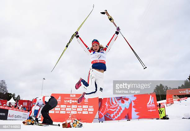 Therese Johaug of Norway celebrates winning the gold medal in the Women's 30km Mass Start CrossCountry during the FIS Nordic World Ski Championships...