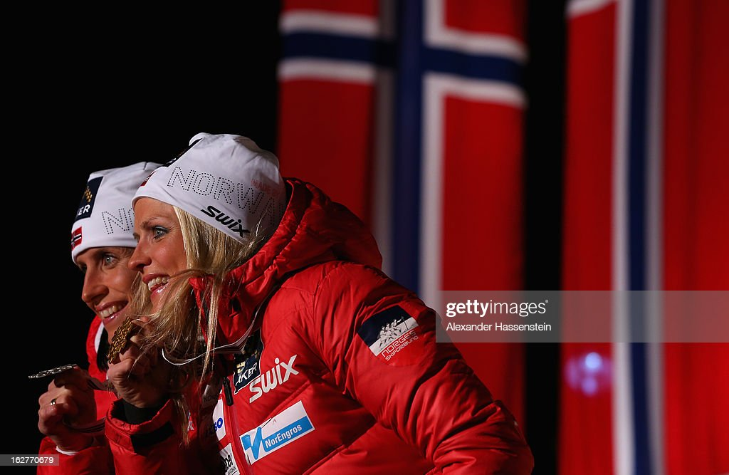 Therese Johaug of Norway celebrates with her Gold medal (r) and Marit Bjoergen of Norway her Silver medal at the medal ceremony for the Women's Cross Country Individual 10km at the FIS Nordic World Ski Championships on February 26, 2013 in Val di Fiemme, Italy.