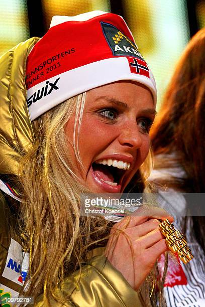 Therese Johaug of Norway celebrates with the gold medal won in the Ladies Cross Country 30km Mass Start race during the FIS Nordic World Ski...