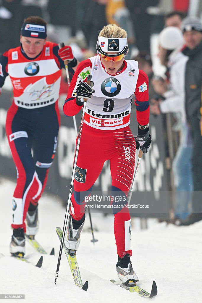 Therese Johaug of Norway follows Justina Kowalczyk of Poland during the mass women for the FIS Cross Country World Cup Tour de Ski on January 8, 2011 in Val di Fiemme, Italy.