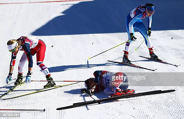 Therese Johaug of Norway Heidi Weng of Norway and AinoKaisa Saarinen of Finland collapse in the snow after finishing the Ladies' Skiathlon 75 km...