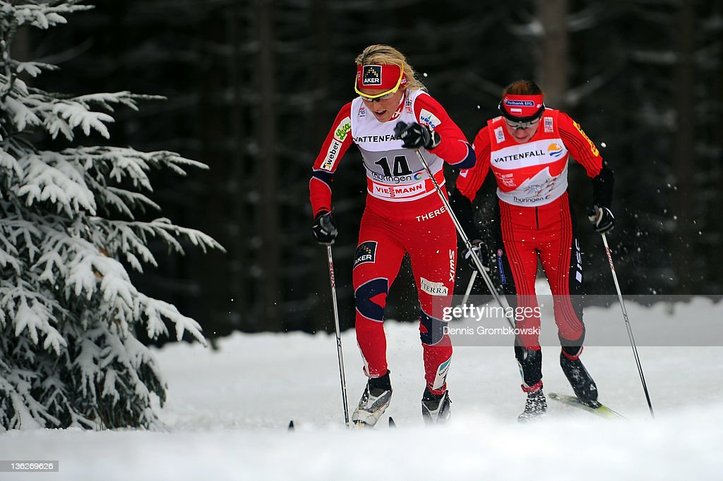 <a gi-track='captionPersonalityLinkClicked' href=/galleries/search?phrase=Therese+Johaug&family=editorial&specificpeople=4176080 ng-click='$event.stopPropagation()'>Therese Johaug</a> (L) of Norway is chased by Justyna Kowalczyk (R) of Poland during the FIS Tour de Ski Oberhof Women's 10km Classic Pursuit at DKB Ski Arena on December 30, 2011 in Oberhof, Germany.