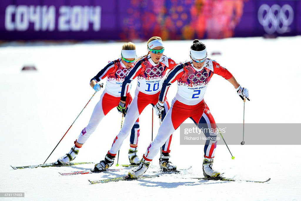 Therese Johaug of Norway, Kristin Stoermer Steira of Norway and Marit Bjoergen of Norway compete during the Women's 30 km Mass Start Free during day 15 of the Sochi 2014 Winter Olympics at Laura Cross-country Ski & Biathlon Center on February 22, 2014 in Sochi, Russia.