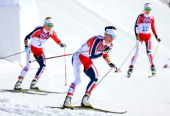 Therese Johaug of Norway Marit Bjoergen of Norway and Kristin Stoermer Steira of Norway compete during the Women's 30 km Mass Start Free during day...