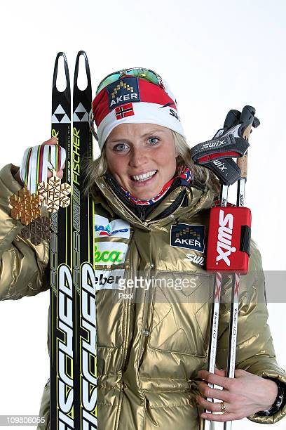 Therese Johaug of Norway poses with the gold medal won in the Ladies Cross Country 30km Mass Start race during the FIS Nordic World Ski Championships...