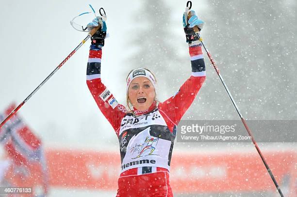 Therese Johaug of Norway takes 1st place during the FIS CrossCountry World Cup Tour de Ski Women's Final Climb on January 05 2014 in Val di Fiemme...