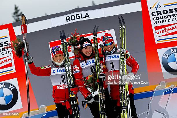 Therese Johaug of Norway takes 2nd place Justyna Kowalczyk of Poland takes 1st place Vibeke W Skofterud of Norway takes 3rd place during the FIS...