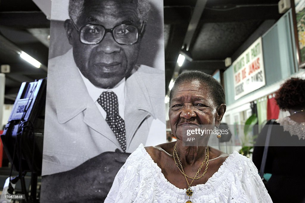 Therese Lupter, a supporter of the Martinican Progressive Party (PPM), poses in front of a portrait of French poet and politician Aime Cesaire, which she met for forty years, on January 21, 2013 at the PPM headquarters in Fort-de-France, on the French Caribbean island of Martinique, during the launch of celebrations marking the 100th anniversary of Cesaire's birth. Cesaire (June 25, 1913 – 17 April 2008) was former mayor of Fort-de-France and had funded the PPM party in 1958. As a pioneer of the black pride movement, Cesaire was a cult figure on his native island of Martinique and in the French-speaking world. With fellow writers such as Leopold Sedar Senghor of Senegal, 'Papa Cesaire' invented the term 'negritude,' which he defined as an 'affirmation that one is black and proud of it', decades before the emergence of Steve Biko or Martin Luther King.
