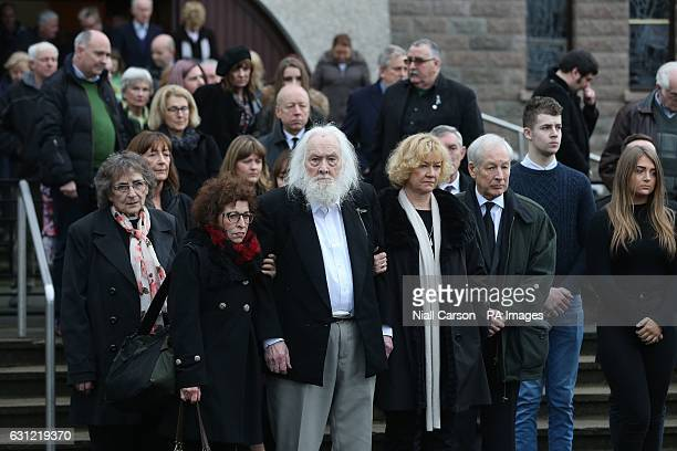 Therese MacGowan's husband Maurice is comforted by family members at the funeral of Therese MacGowan the mother of singer Shane MacGowan at Our Lady...