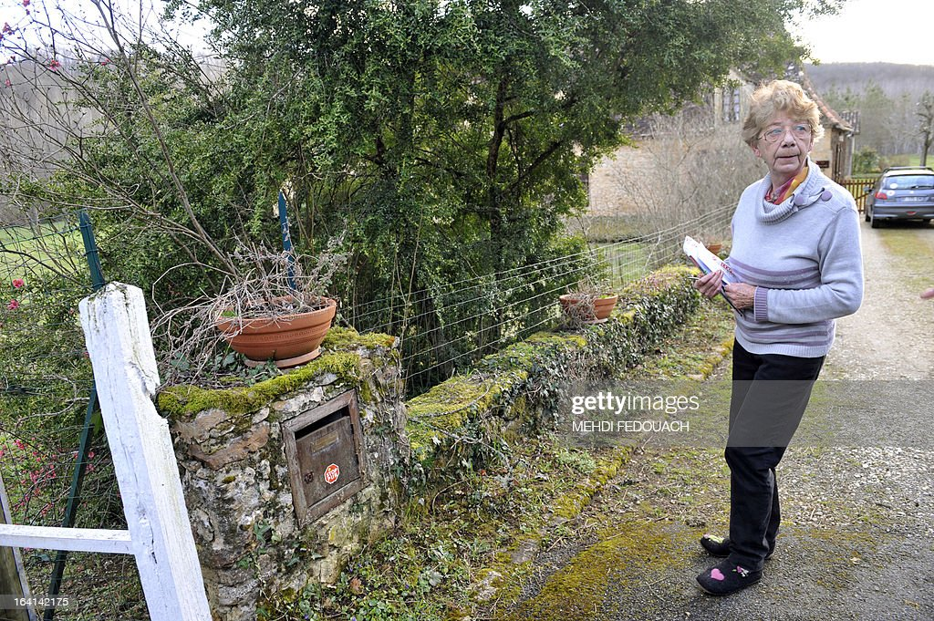Therese Verdon, Philippe Verdon's mother-in-law, a French hostage apparently kidnapped by Al-Qaeda in the Islamic Maghreb (AQIM), stands in front of the family home in the southwestern French city of Montferrand-du-Perigord, on March 20, 2013. Verdon was seized on November 24, 2011 along with Serge Lazarevic from their hotel in Hombori, northeastern Mali, during a business trip. The French government was scrambling today to verify a claim by Al-Qaeda's north African branch that it has executed a French hostage in Mali as a 'spy'. A man claiming to be a spokesman for Al-Qaeda in the Islamic Maghreb (AQIM) told Mauritania's ANI news agency on March 19, that Philippe Verdon had been executed on March 10 'in response to France's intervention in Northern Mali'. AFP PHOTO / MEHDI FEDOUACH