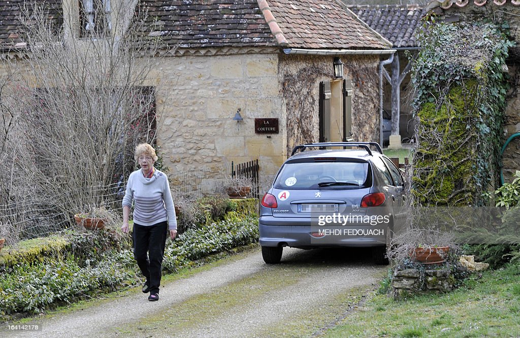 Therese Verdon, Philippe Verdon's mother-in-law, a French hostage apparently kidnapped by Al-Qaeda in the Islamic Maghreb (AQIM), walks past the family home in the southwestern French city of Montferrand-du-Perigord, on March 20, 2013. Verdon was seized on November 24, 2011 along with Serge Lazarevic from their hotel in Hombori, northeastern Mali, during a business trip. The French government was scrambling today to verify a claim by Al-Qaeda's north African branch that it has executed a French hostage in Mali as a 'spy'. A man claiming to be a spokesman for Al-Qaeda in the Islamic Maghreb (AQIM) told Mauritania's ANI news agency on March 19, that Philippe Verdon had been executed on March 10 'in response to France's intervention in Northern Mali'.