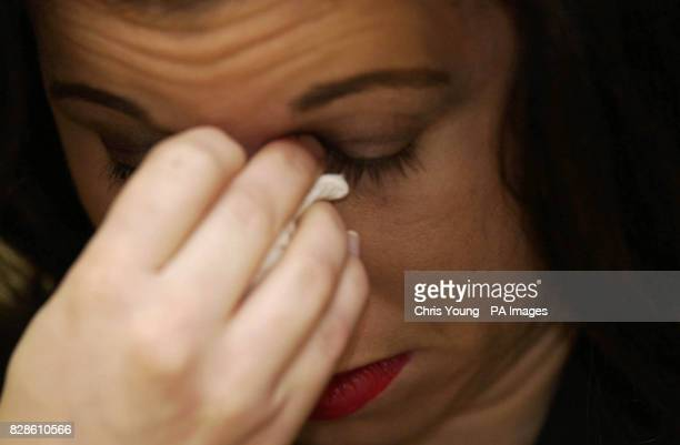 Theresia Muller the sister of the murdered artist Margaret Muller weeps during a press conference at Bethnal Green Police Station in East London at...