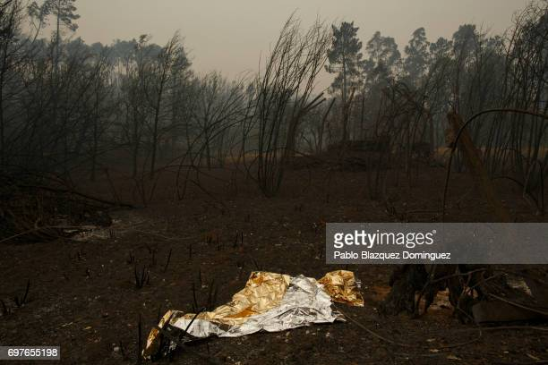 A thermal blanket lays on the ground in the forest after a wildfire took dozens of lives on June 19 2017 near Castanheira de Pera in Leiria district...