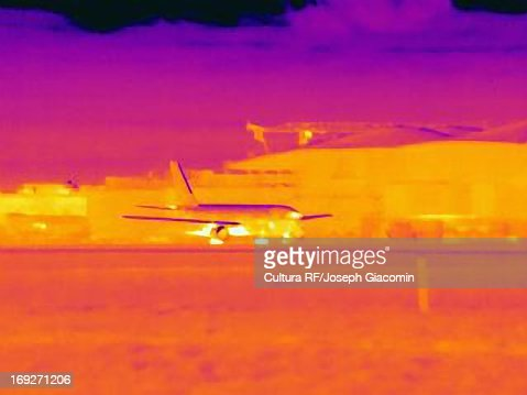Thermal image of airplane landing : Stock Photo