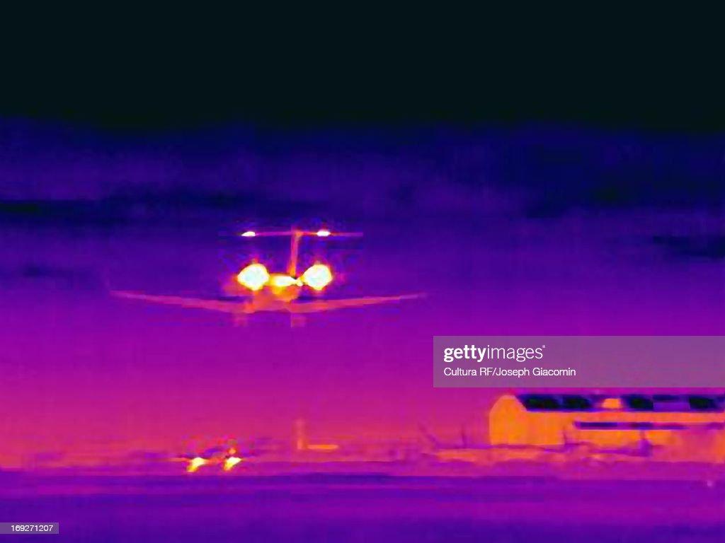 Thermal image of airplane landing : Stock Photo
