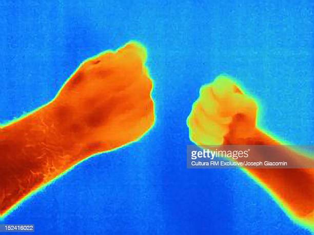 Thermal image of hands playing game