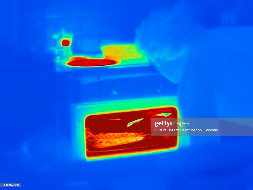 Thermal image of man cooking in kitchen : Stock Photo