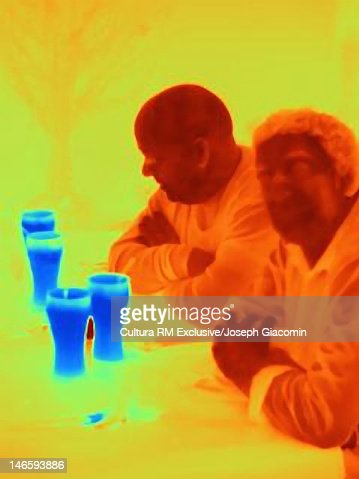 Thermal image of men having beer at bar : Stock Photo