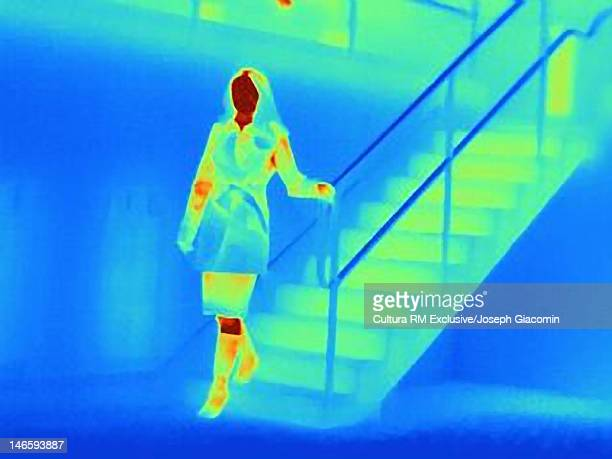 Thermal image of woman climbing staircase