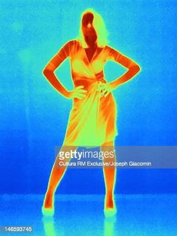 Thermal image of woman posing against wall