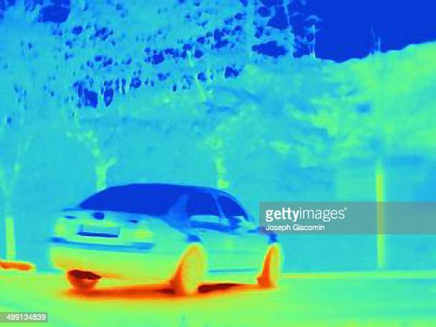 Thermal image which reveals the heat of the tyres and exhaust of a speeding car