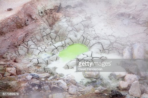 Thermal pool surrounded by dried mud, Wyoming, USA : Stock Photo