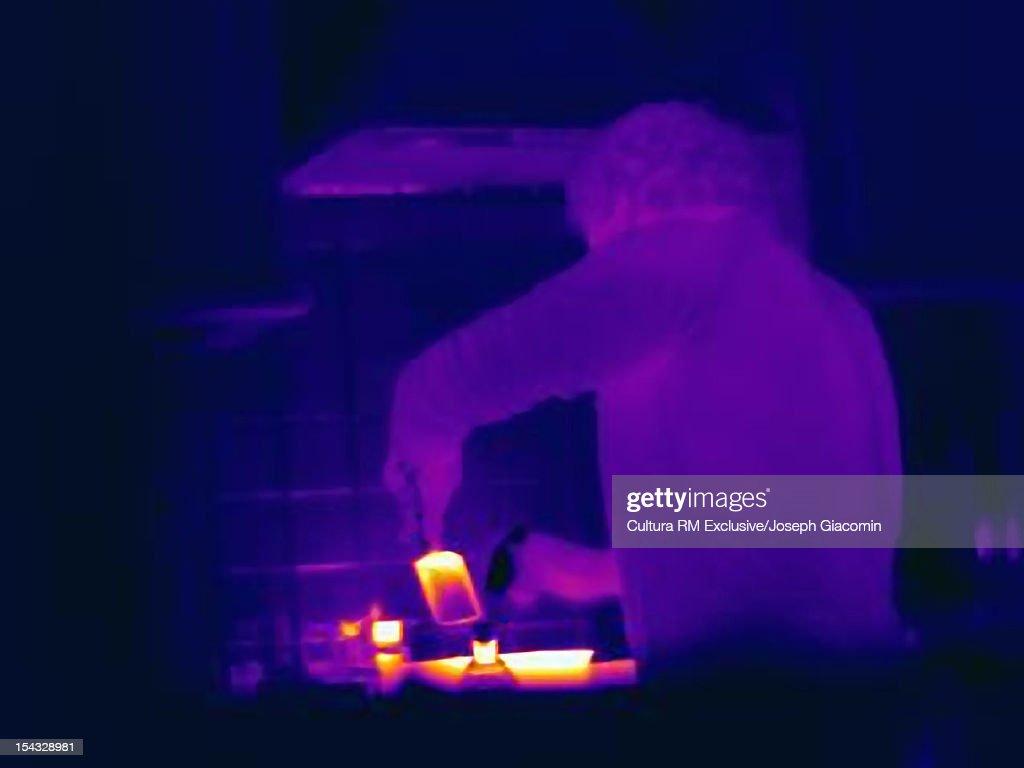 Thermal view of man cooking : Stock Photo
