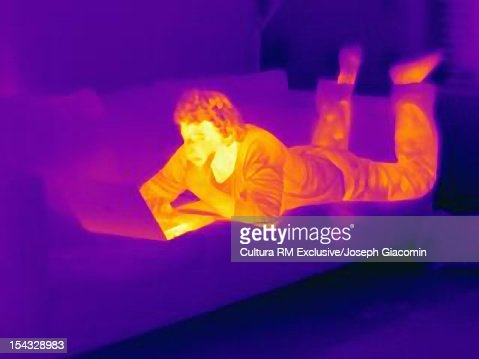 Thermal view of man using laptop