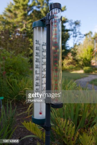 Thermometer And Rain Gauge In A Garden Stock Photo Getty Images