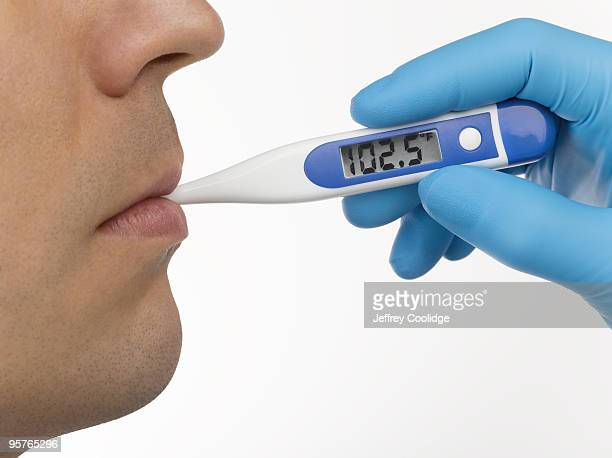 Thermometer in Man's Mouth