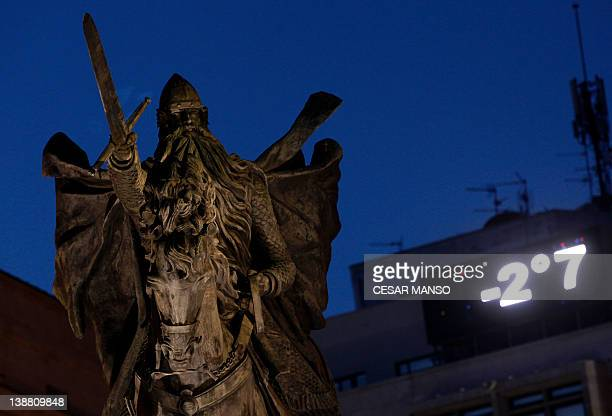 A thermometer marks 27 Celsius behind the statue of El Cid on a cold winter evening on February 12 in the city of Burgos where temperatures are...