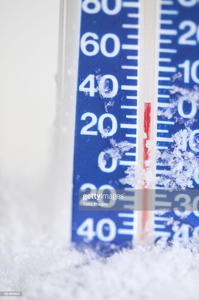 A thermometer on ice reading 35 degrees