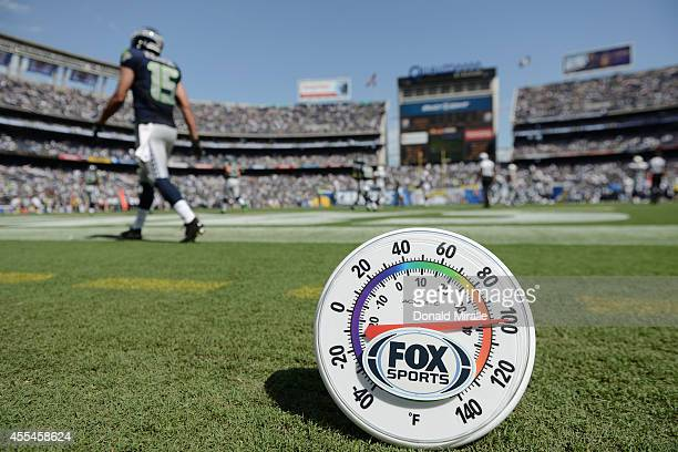 A thermometer on the field shows a temperature of 100 degrees Fahrenheit during the third quarter as the Seattle Seahawks the Seattle Seahawks play...