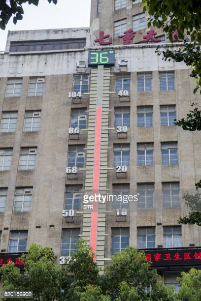 A thermometer on the side of a building shows the temperature in Shanghai on July 21 2017 Shanghai sweltered under a new record high of 409 degrees...