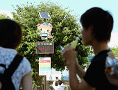 A thermometer reads 42 degrees Celsius in front of Tatebayashi station on August 5 2014 in Tatebayashi Gunma Japan The 'official' highest temperature...