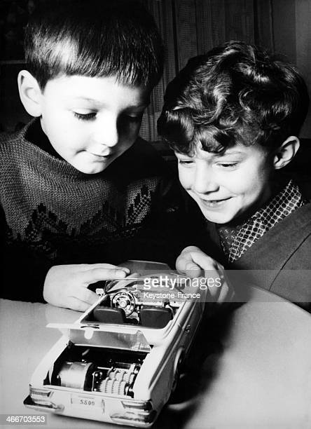 These 2 boys discover new toy car at 16th International Toy Fair a Mercredes 230 SL with a complete synchronised gear change with reserve gear and...