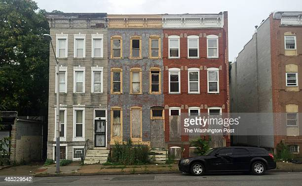 These abandoned and boarded apartments once provided some of it's occupants with lead poisoning on the 1700 block of Mosher Street in Baltimore...