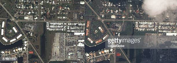 These are satellite images of Punta Gorda Florida featuring a before and after image of the area after a Hurricane hit the area