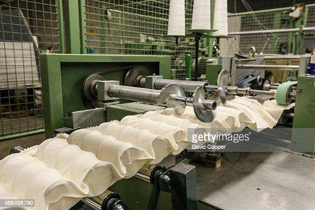 These are the cotton pockets as the springs are inserted and pushed into place Brad Warner managing partner of Marshall Mattress and his son Eric...