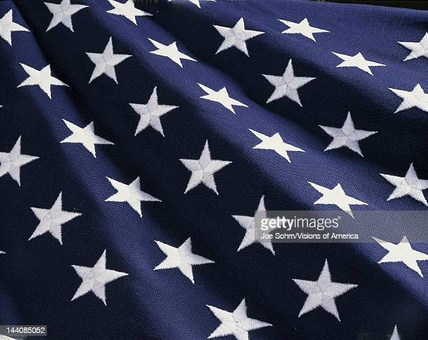 These are the stars of the American flag They are against their blue field climbing upward toward the corner of the image as if they were situated on...